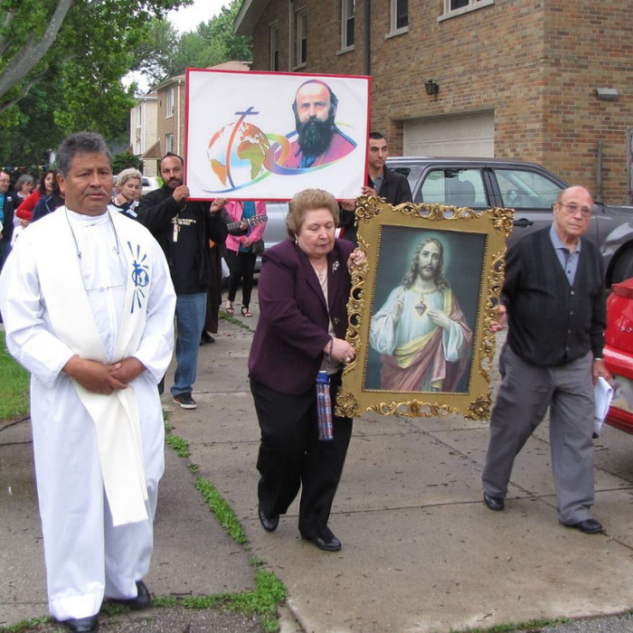 Comboni Missionary priest and parishioners in outdoor procession